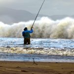 Patrick O'Sullivan from Tralee who took part in Waterville shore angling competition on Saturday last trying to cope with the rough conditions on Ballinskelligs Beach.